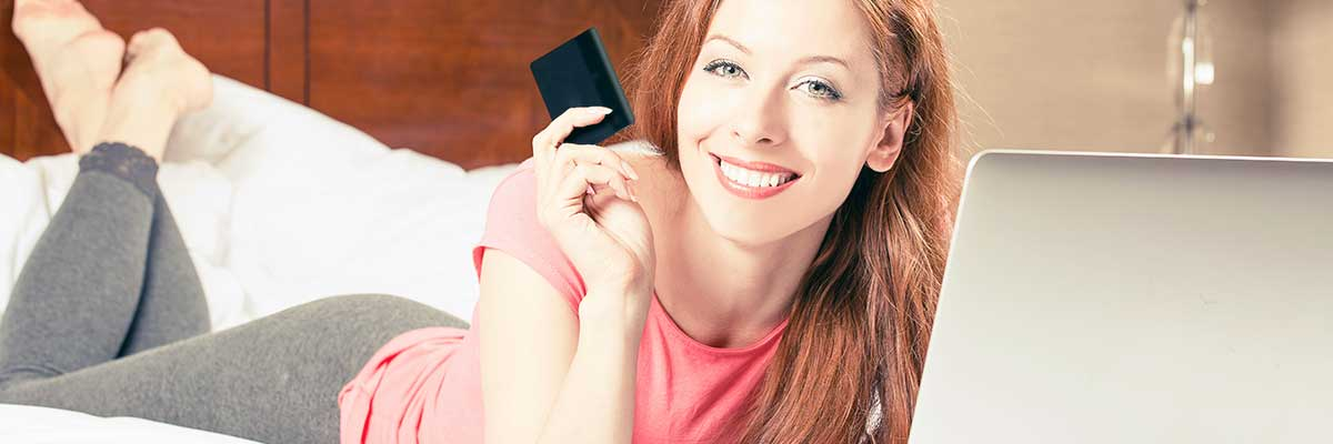 bed price woman with credit card on beds